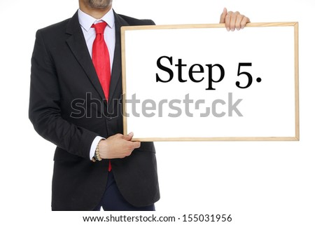 Businessman with a white board step 5. - stock photo