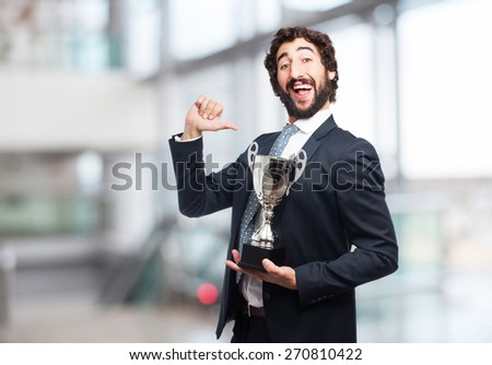 businessman with a winner cup - stock photo