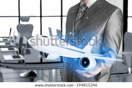 Businessman with airplane over his hand - stock photo