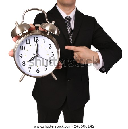 Businessman with Alarm Clock isolated on white. Time concept