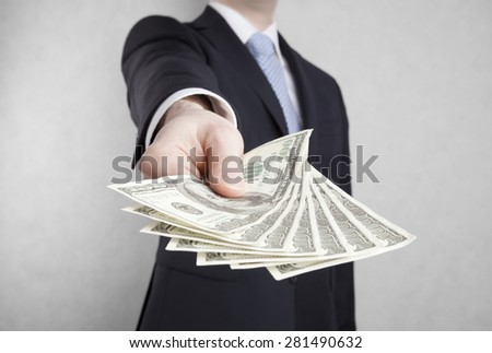 Businessman with american dollars. Clipping path included. - stock photo