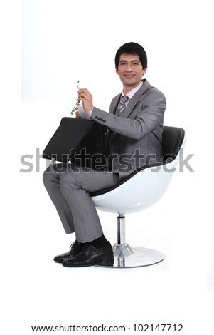 Businessman with an open briefcase - stock photo