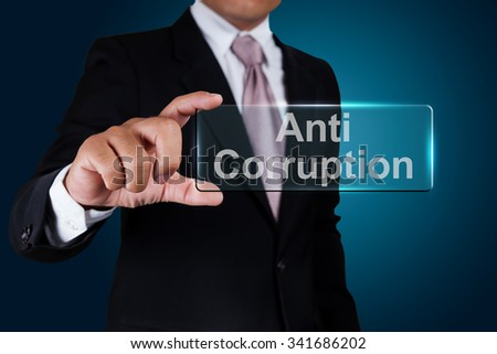 Businessman with anti corruption text label. - stock photo