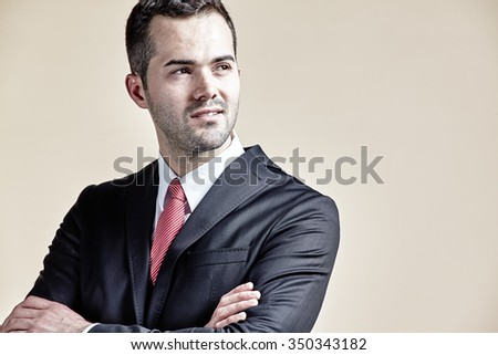 Businessman with arms crossed looking up isolated - stock photo