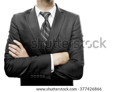Businessman with arms crossed on a white background - stock photo