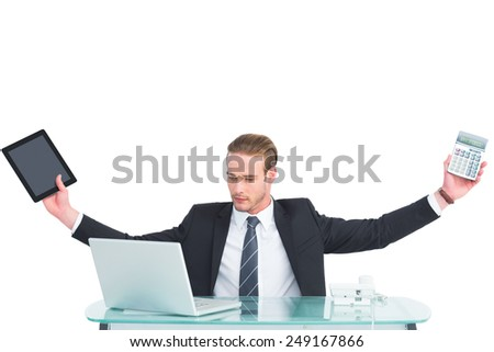 Businessman with arms up holding tablet and calculator on white background - stock photo