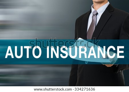 Businessman with AUTO INSURANCE  WORD - stock photo