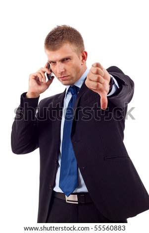Businessman with bad news on his cell phone disapproving - stock photo