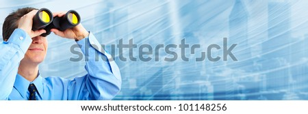 Businessman with binocular. Abstract techno background. - stock photo