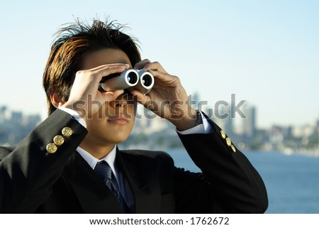 Businessman with binoculars, can be used for business vision/prospect metaphor - stock photo