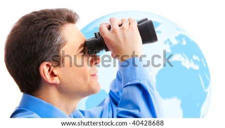 businessman  with binoculars looking at the globe - stock photo