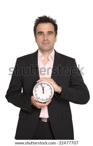Businessman with black suit hold in front of him, a silver metal wall clock - stock photo