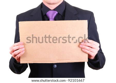 businessman with blank cardboard sign - stock photo