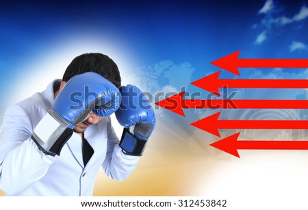 businessman with boxing glove guarding his face, business concept - stock photo