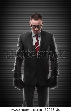 businessman with boxing gloves - stock photo