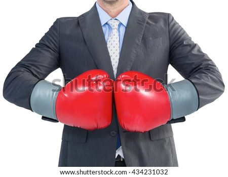 Businessman with boxing gloves in white background