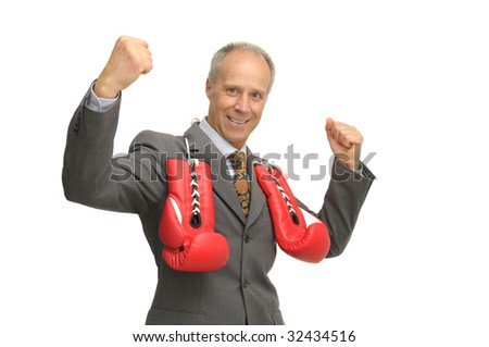 Businessman with boxing gloves isolated against a white background - stock photo