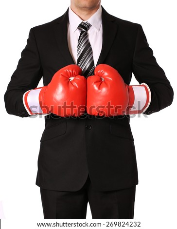 Businessman with boxing gloves isolated on white - stock photo