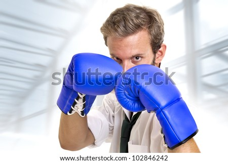 Businessman with boxing gloves posing - stock photo