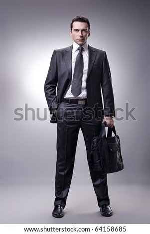 Businessman with briefcase - stock photo