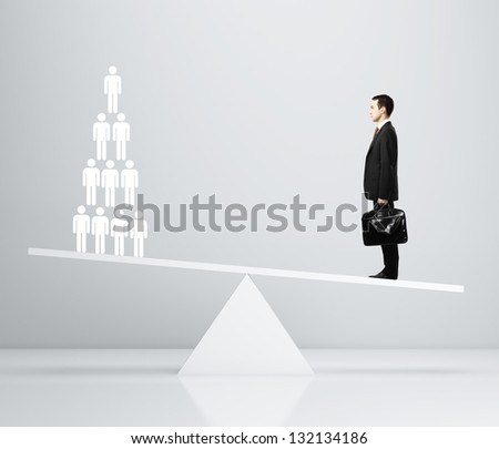 businessman with briefcase and 3d people on scales - stock photo