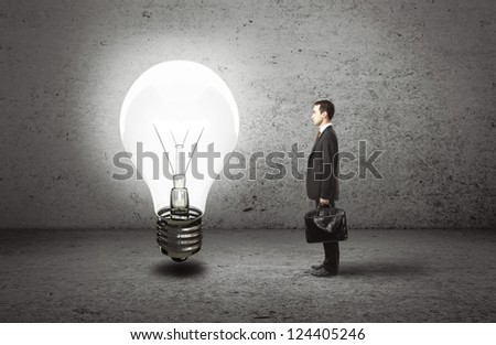 businessman with briefcase and lamp, idea concept - stock photo