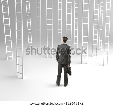 businessman with briefcase and many ladder - stock photo
