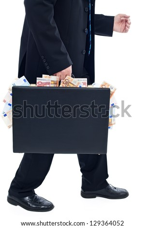 Businessman with briefcase full of money - stock photo