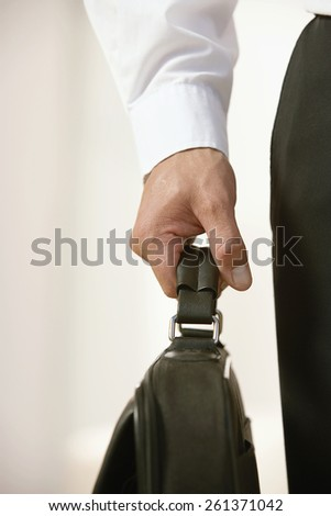 Businessman with briefcase in hand  - stock photo