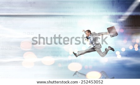 Businessman with briefcase jumping against digital background - stock photo