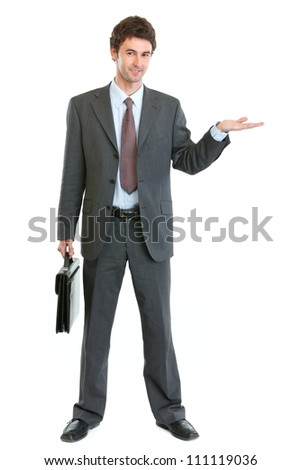 Businessman with briefcase presenting something on empty hand