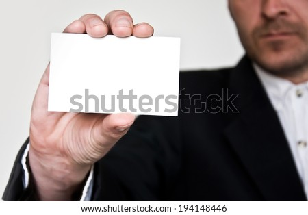 businessman with business card - stock photo