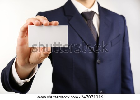 Businessman with business card, close-up - stock photo
