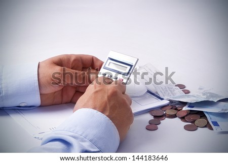 businessman with calculator - stock photo