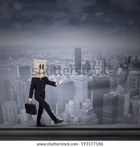 Businessman with cardboard head concept for lost, searching, confusion and challenge