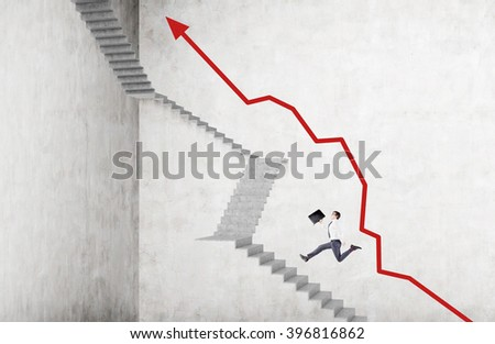 Businessman with case running up steep stairs, red graph along it. Concrete background. Concept of career growth. - stock photo