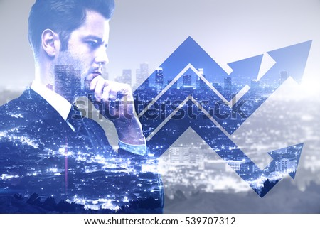Businessman with chart arrows on blue city background. Finance concept, Double exposure
