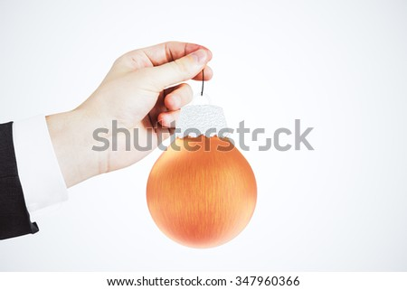 Businessman with christmas tree red ball  - stock photo