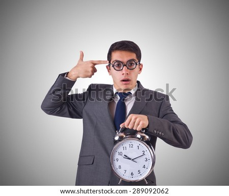 Businessman with clock against the gradient - stock photo