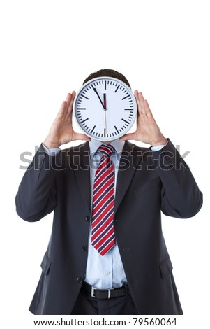 Businessman with clock in front of face as an expression of stress.Isolated on white background..