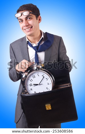 Businessman with clock isolated on white - stock photo