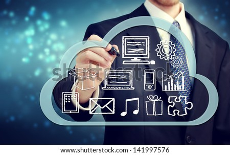 Businessman with cloud computing concept on blue background - stock photo
