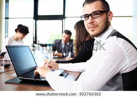 Businessman with colleagues in the background - stock photo