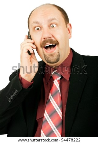 Businessman with crazy eyes talking by mobile phone, and receiving amazing, good and exciting news, laughing out loudly, isolated on white background