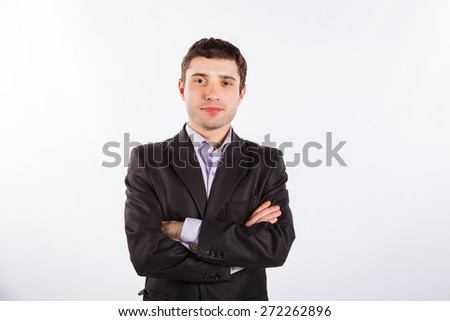 Businessman with crossed arms over white background - stock photo