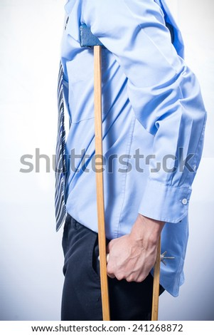 businessman with crutches, white background. Disabled person in work. - stock photo