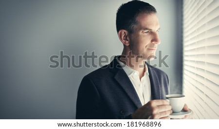 Businessman with cup of coffee - stock photo