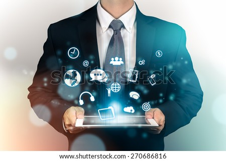 Businessman with digital table in hand, social media icon.concept ,education - stock photo
