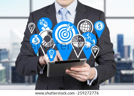 businessman with digital tablet and drawing business icons - stock photo