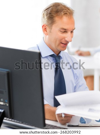 businessman with documents in office
